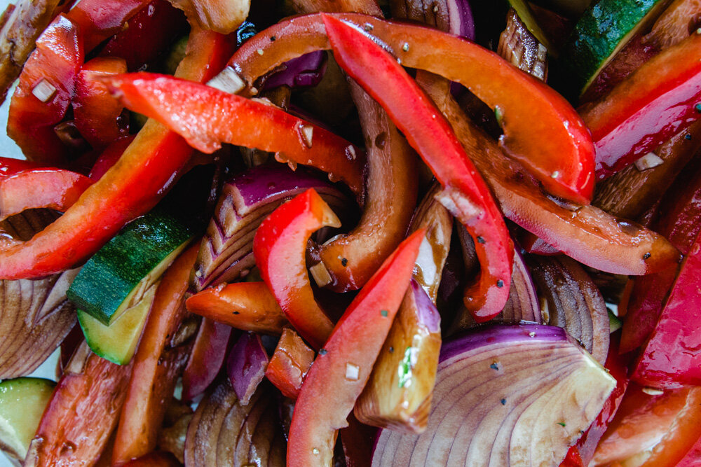 veggies roasting on a pan. from the post: how to meal prep