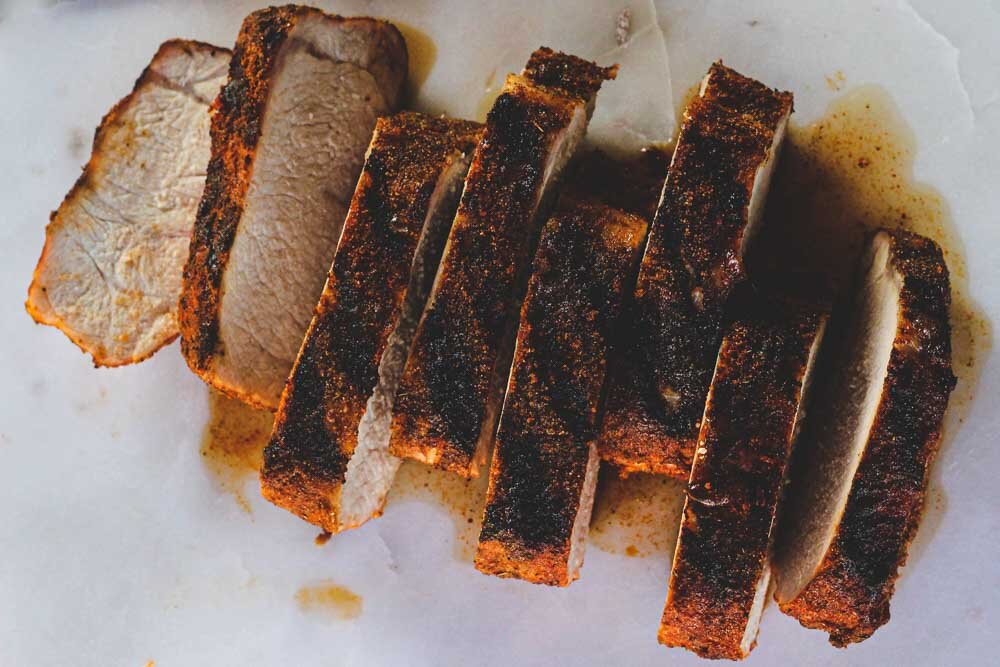 smoky grilled pork loin sliced and ready to be served. get the recipe in this post!